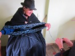 senior lady spinning wool